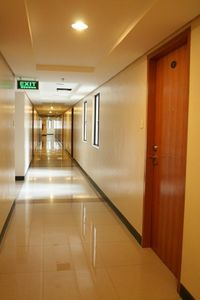 Corridor to Elevator at exit sign