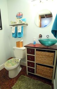 Restroom with vessel sink.