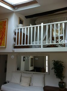 View of mezzanine and bedroom from staircase