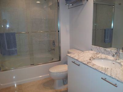 Impeccable bathroom with shower and tub. All marble floor.