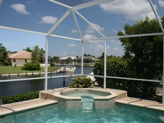 Vacation Homes in Marco Island house photo - Marco Getaway pool and waterfall jacuzzi overlooking lagoon.