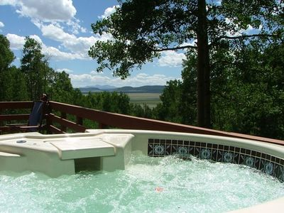 Relaxing Hot Tub on the Front Porch with Picture Postcard Mountain Views.