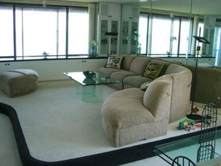 The living room with adjoining dining area, both overlooking the Gulf of Mexico.