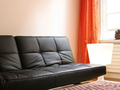 Cinna designer sofa - sleeps 2 more guests - If you might have an extra guest, you can make use of the designer Cinna fold out leather sofa with a flexible footrest almost as big as the sofa itself.