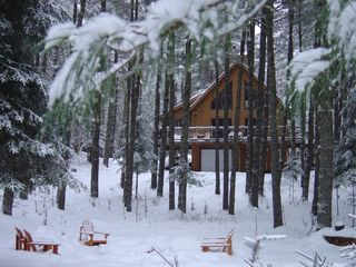 Paul Smiths chalet photo - Enjoy apres ski drinks around a campfire