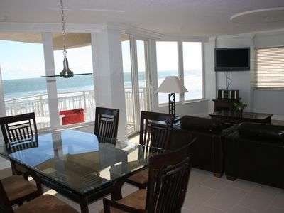 View of large living space, and beach balcony access