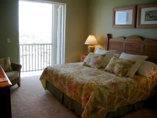 .Master Bedroom with French Doors over looks water.