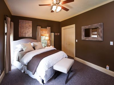 Bedroom featuring 1 queen bed and 1 pull-out twin bed.