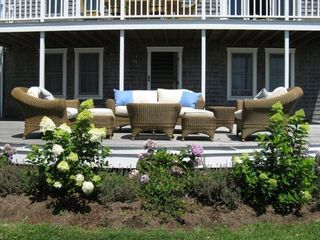 Madequecham house photo - Lower Deck with comfy outdoor wicker seating, upper deck with outdoor dining set