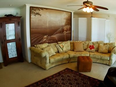 Living room with rustic art work