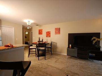 Flat screen television and dining area