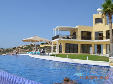 Two bedroomed secluded villa with great sea views in around the farmlands.