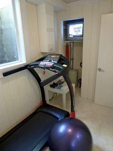 Small exercise room with TV and DVD.