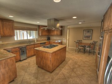 Kitchen and breakfast area. Built in thermostat controlled wine storage.