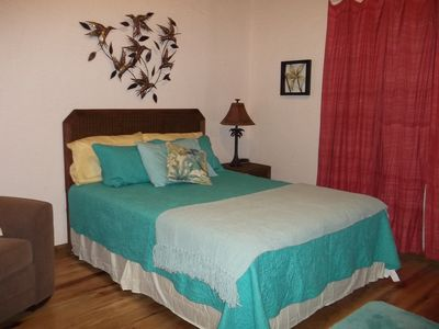 Large Downstairs 2nd bedroom with attached full bath. Queen size bed and single