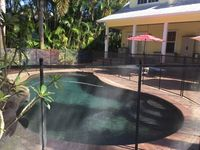 Beautiful private home with pool/waterfall & only 5 min to the local beaches.