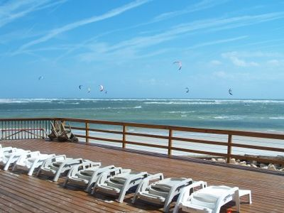 Enjoy the ocean spray with kite boarders providing entertainment out front