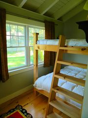 The bedroom with Queen bunk beds - Harpswell cottage vacation rental photo