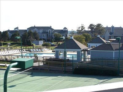 Direct view of the olympic pool and tennis courts from the deck