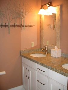 Master bath has a double vanity and large shower with 2 shower heads
