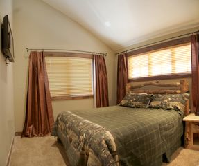 Silverthorne townhome photo - Bedroom 4 has a king size lodgepole bed and a flat screen tv.