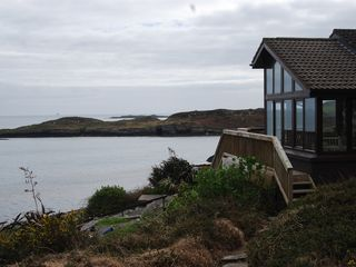 Mizen Head bungalow photo - Spanish Point in the foreground. Fastnet Rock on the horizon.
