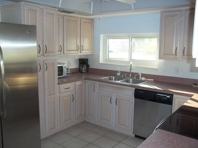Kitchen with all new appliances, microwave, dishwasher, coffee maker, stoneware