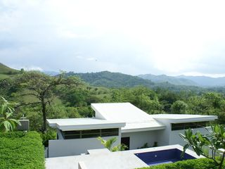 Nicoya house photo - The Guest House, which is for rent, is located just stepped from infinity pool.