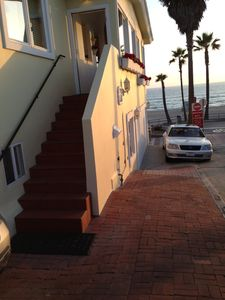 Stairs to Vacation Rental Parking spot on bricks parallel to stairs