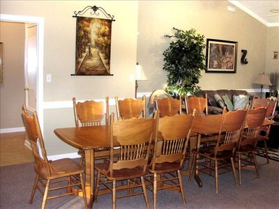 Dining for 10 with additional seating at breakfast table in kitchen and bar.