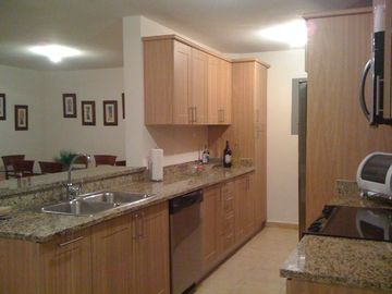 Granite countertops, dishwasher, coffee machine and stainless steel appliances