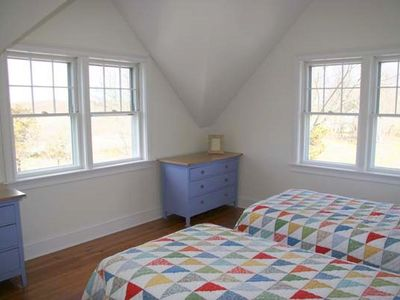 The west bedroom has two twin beds, a full bath, and great views of the moors.