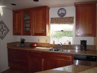 Coronado house photo - Kitchen - cherry cabinets, granite countertops and stainless steel applicances