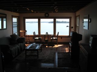 Freeport cottage photo - Living room is a very bright room. Hard wood floors and a sleep sofa.
