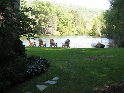 Looking East from the side of the house - Chairs and Boat