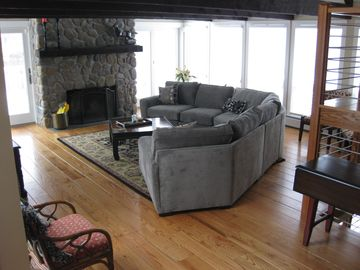 Stay warm in front of the floor-to-ceiling fieldstone fireplace