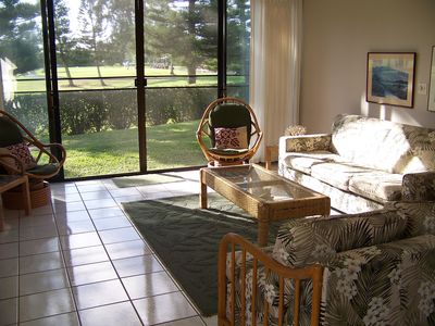 Relax in the bright and spacious living room as you look onto the golf course.