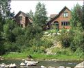Beautiful setting on the Eagle River (home on left) - Avon townhome vacation rental photo