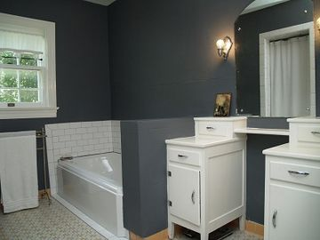 Upstairs WC with dressing vanity and clawfoot bathtub and walk in shower