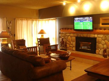 Watch the game on the 42-inch LCD HDTV or relax in front of the gas fireplace