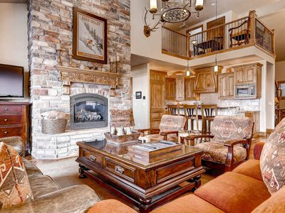 Open concept mountain contemporary home, vaulted ceilings, floor to ceiling stone fireplace, high quality furnishings, fixtures & flooring throughout.