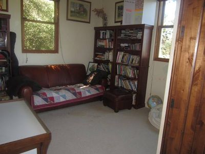 Den with books, t.v., Wii. Surround sound stereo control located in den also.