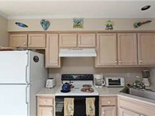 North Ocean City townhome photo - Kitchen cabinets and appliances in view.