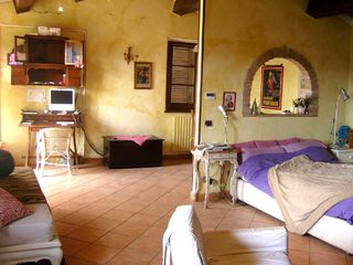 Chiusi villa photo - Annex: main room with a double queen and one single bed. Fireplace and TV.