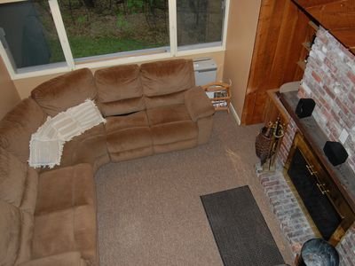 Campton condo rental - Cozy sunken living room with wood burning fireplace and wooded scenic view.
