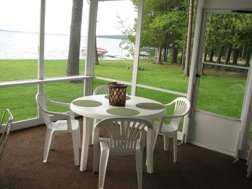 Screened in porch overlooks Elk Lake