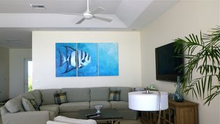 "Providenciales - Provo villa photo - Entertainment area, 65"" flat screen, bluray and Bose stereo with CD / I Pod dock"