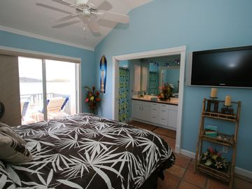 Night Palms Master Bedroom 2 upstairs. Full Ensuite bathroom with private deck.
