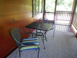 Pigeon Forge cabin photo - Seating and Dining area on the carpeted Screened-In Porch with Fans and Lights.