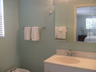 Master bath with large tiled shower and bidet - Siesta Key house vacation rental photo